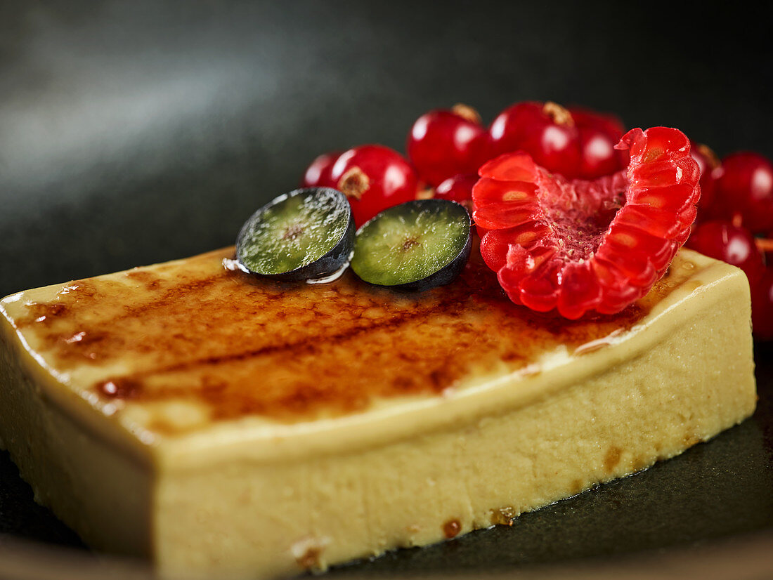 Palatable mousse de foie with ripe berries served on plate
