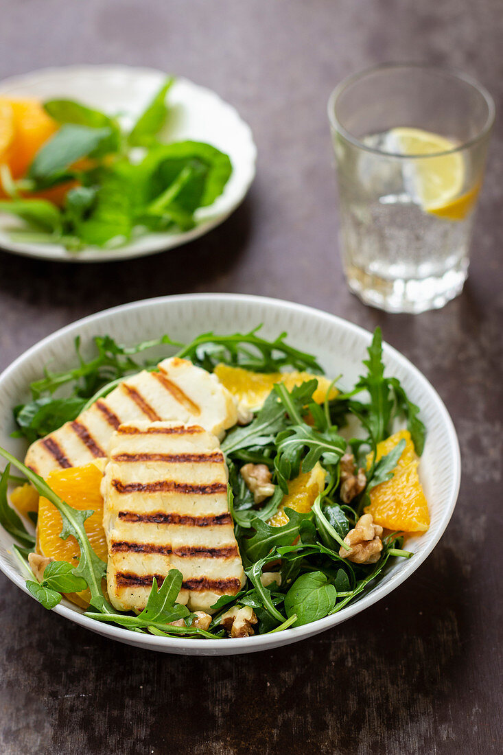 Grilled halloumi on a rocket salad with orange and walnuts