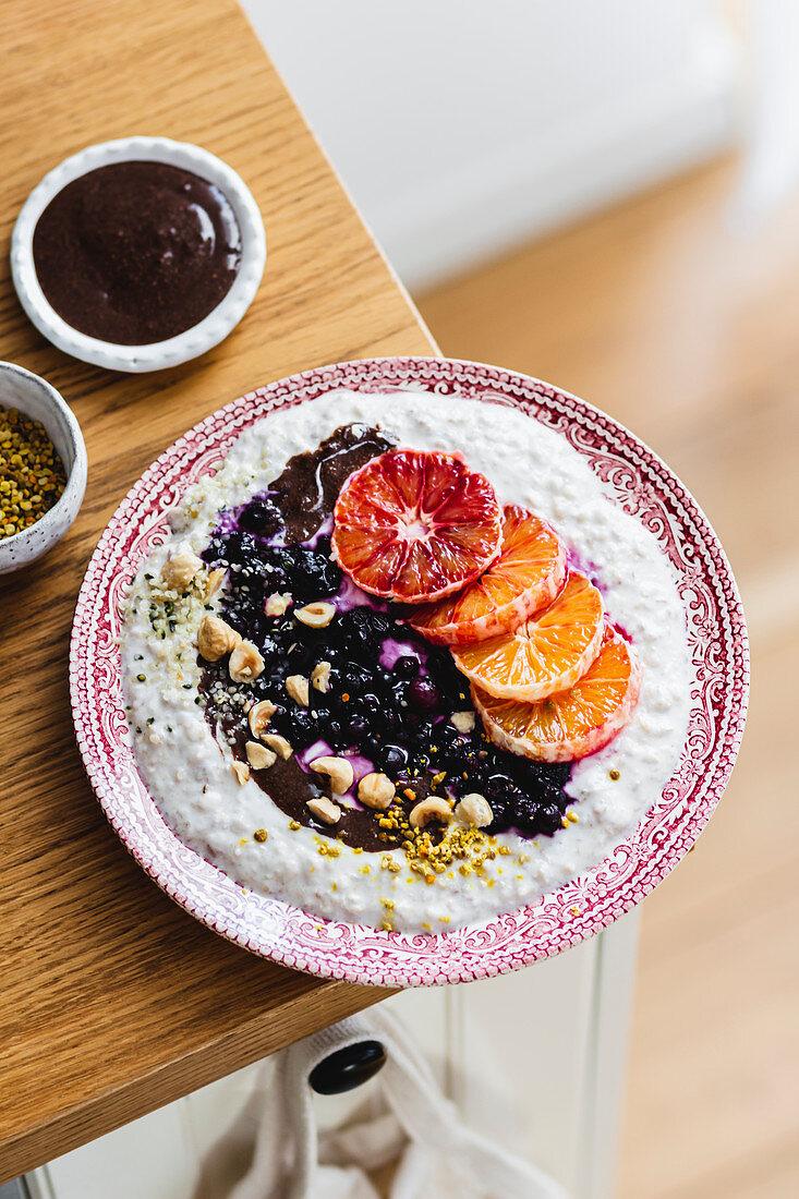 Porridge with blood oranges and blueberries