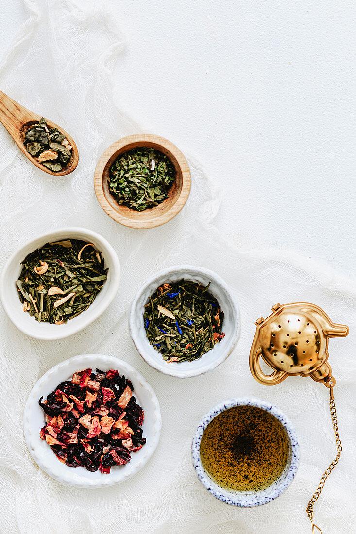 Tea leave varieties and cup of tea