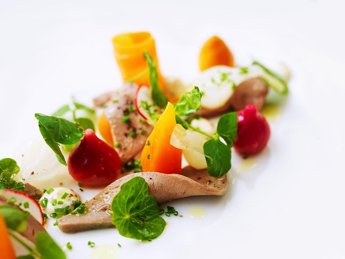 Beef tongue with baby vegetables, radishes and watercress