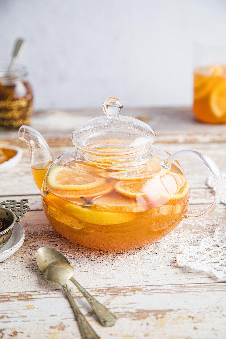Winter orange tea on wooden background