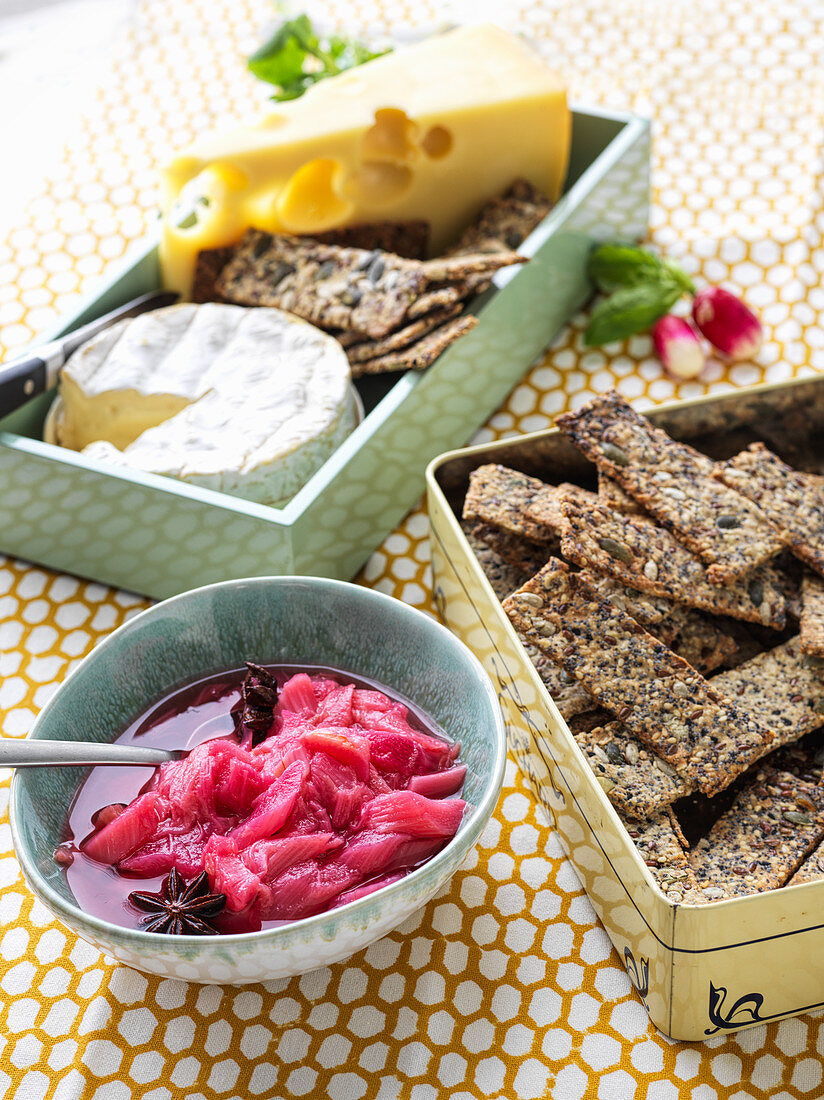 A selection of cheese with crispbread and rhubarb compote
