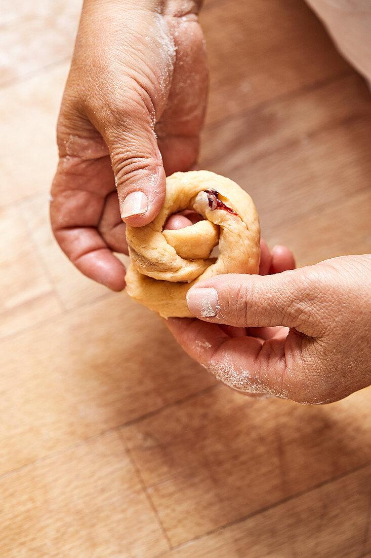 A yeast bun knot being made