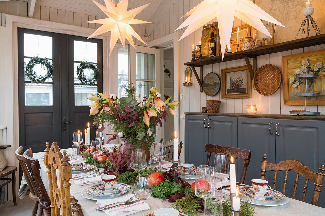 Festively set table in dining room decorated for Christmas