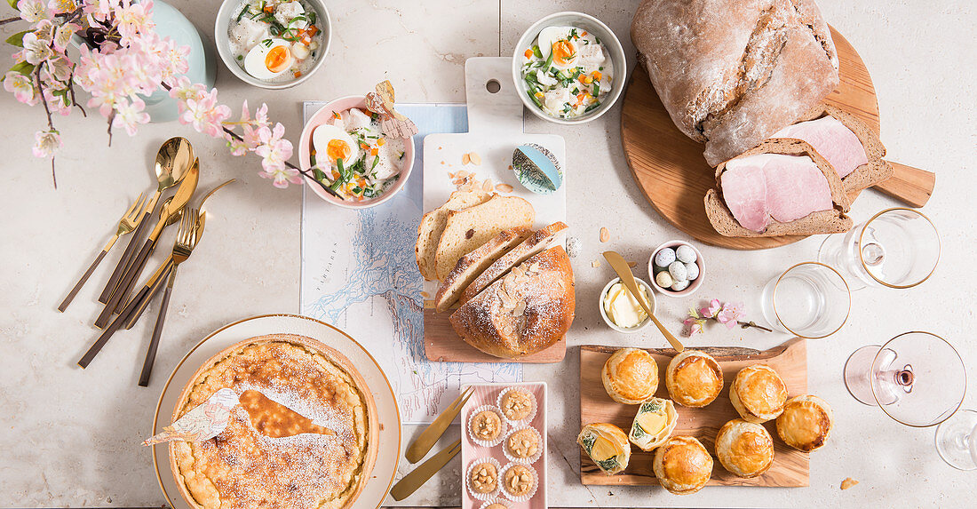 An Easter buffet with soup, ham wrapped in bread, and sweet and savoury pastries
