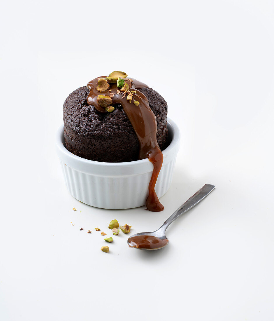 Chocolate souffle with salted caramel and pistachio nuts