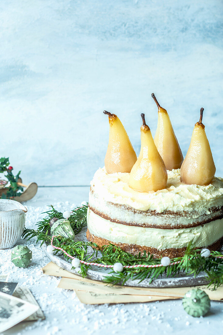 Christmas cake with vanilla frosting and pears