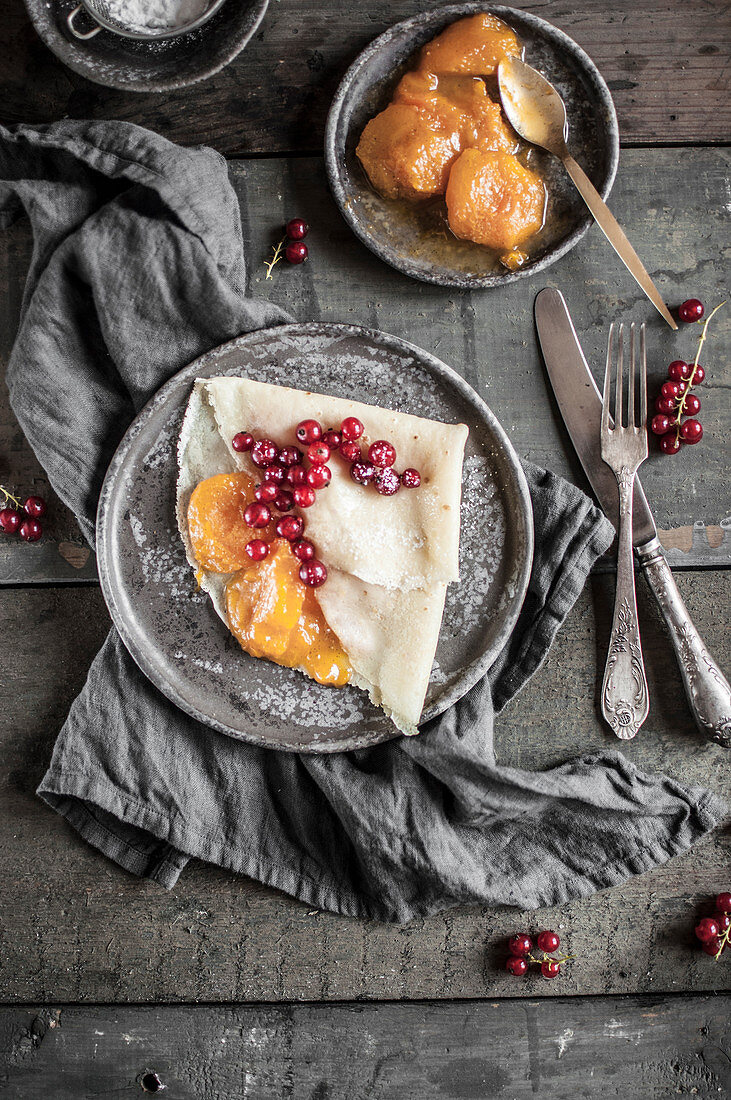 Crepes with caramelised apricots and fresh red currant