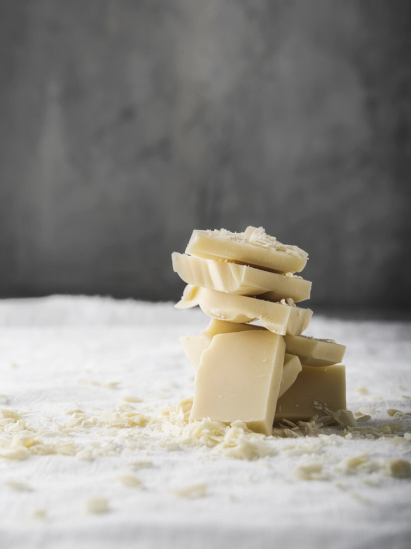 Chunks of white chocolate on white linen