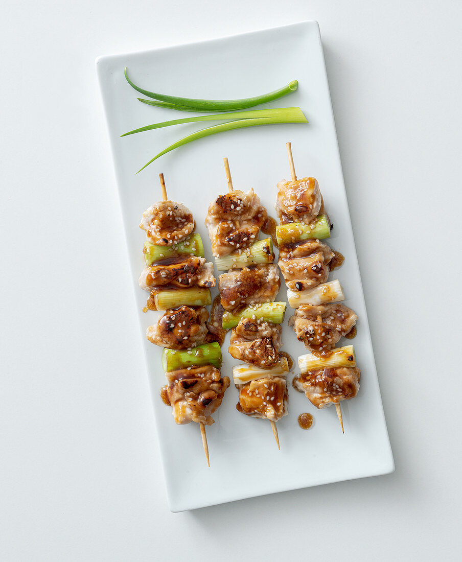 Yakitori with spring onions and a soy and honey sauce