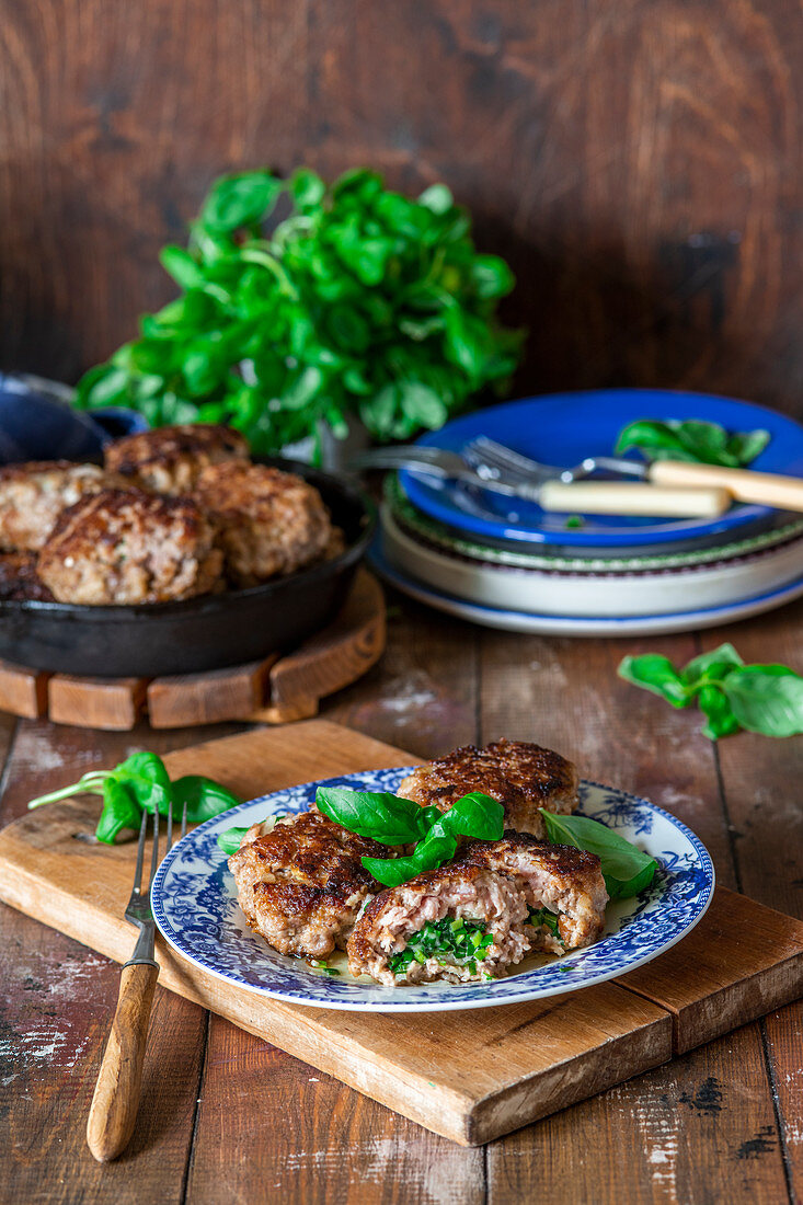 Minced meat cakes (balls) with herbs butter filling