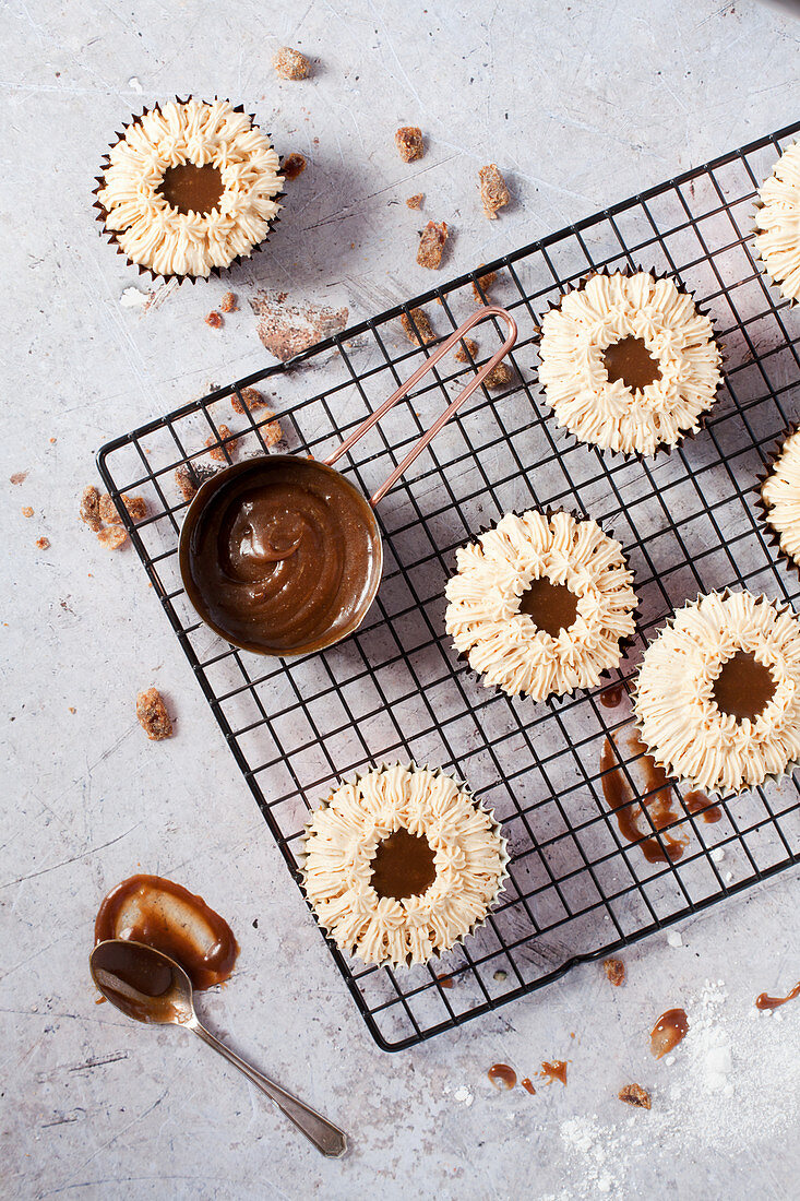 Overhead view of sticky toffee cupcakes on a cooling rack