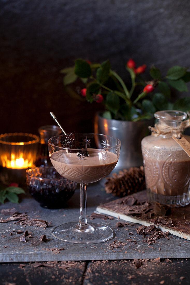 Chocolate liqueur served in vintage glasses with dark cherries