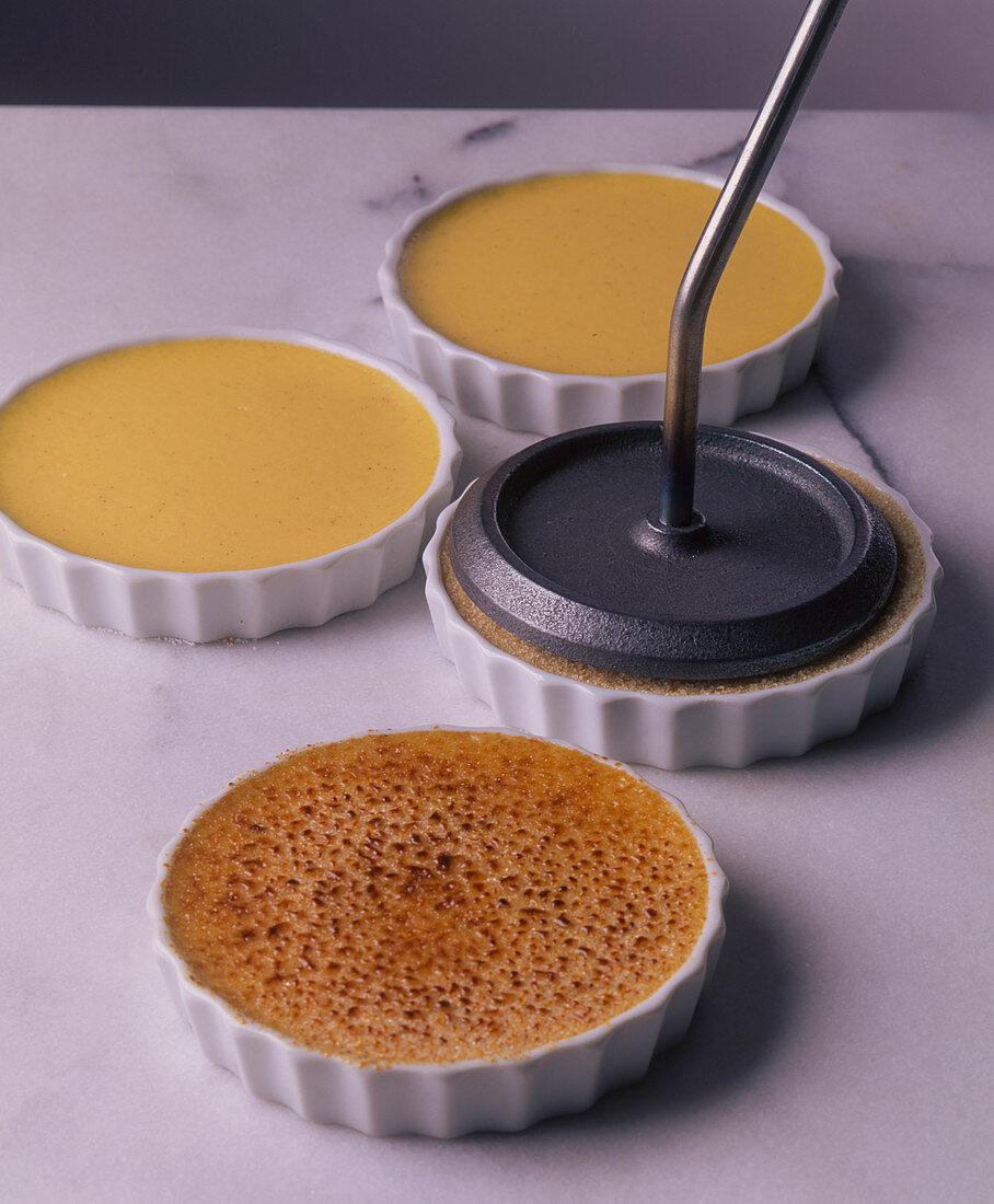 Vanilla cream being caramelised with a caramelising iron