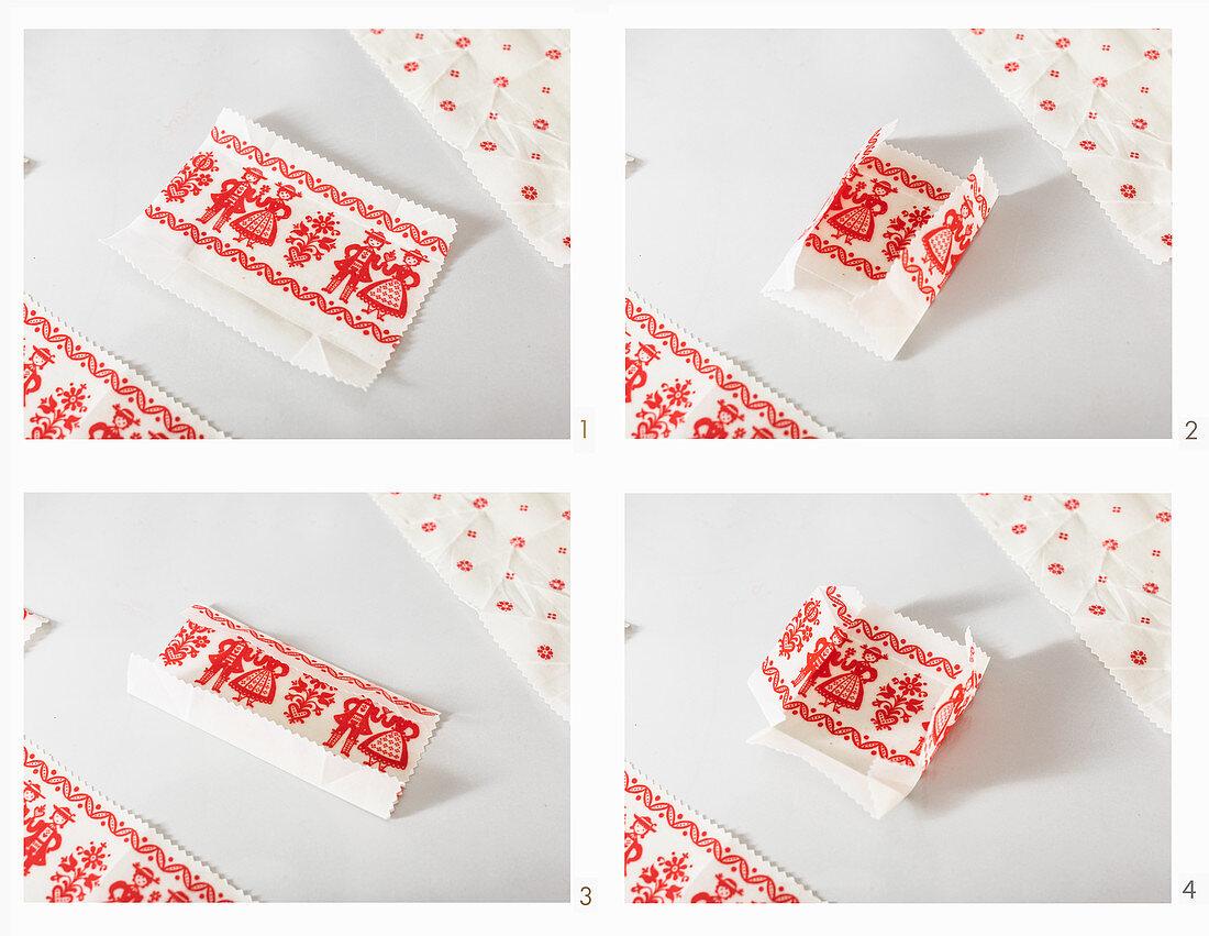 Folding handmade wax wrap into a small storage bowl