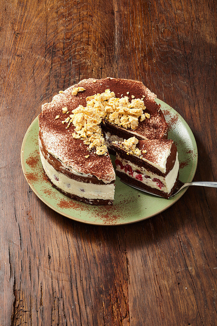 Crispy mascarpone cake decoration with chocolate-coated cornflake clusters