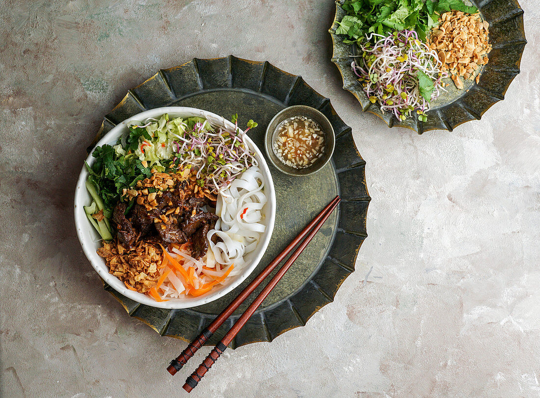 Bun Bo Nam Bo - Vietnamese noodle salad with beef, rice noodles, fresh herbs, pickled vegetables and fish sauce