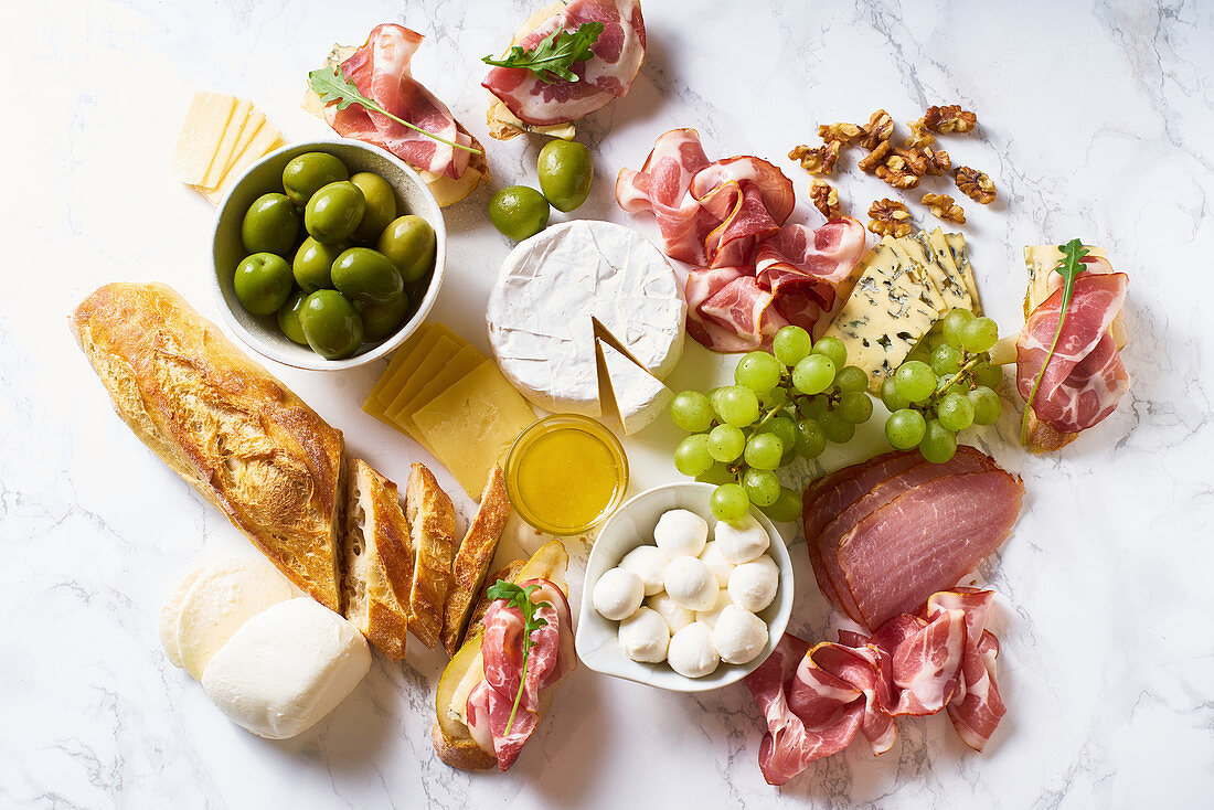 Big plate of appetizers for party of breakfast: gourmet cheese and meat