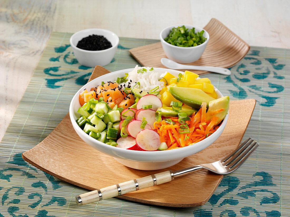 A poke bowl with salmon, mango and avocado