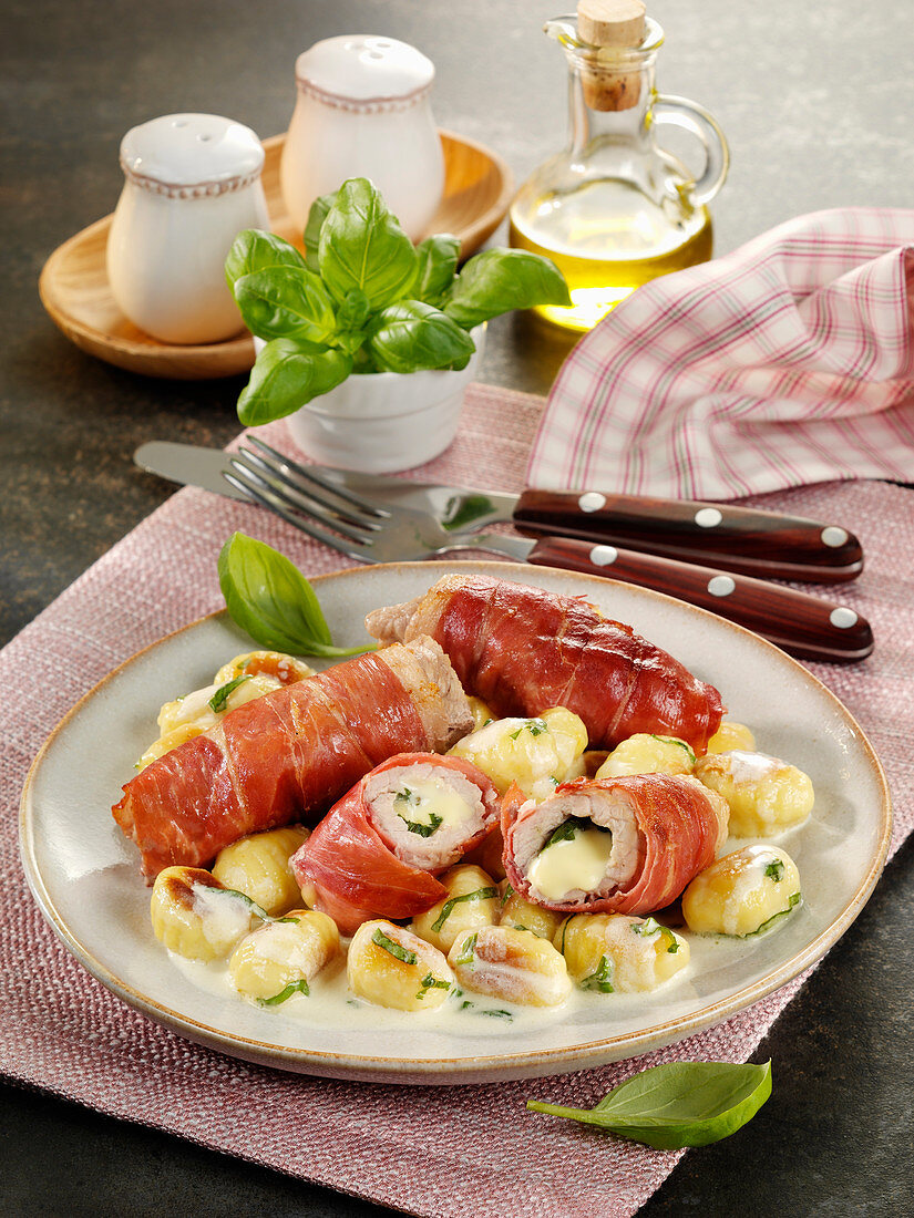 Saltimbocca rolls filled with basil and cheese and served with gnocchi