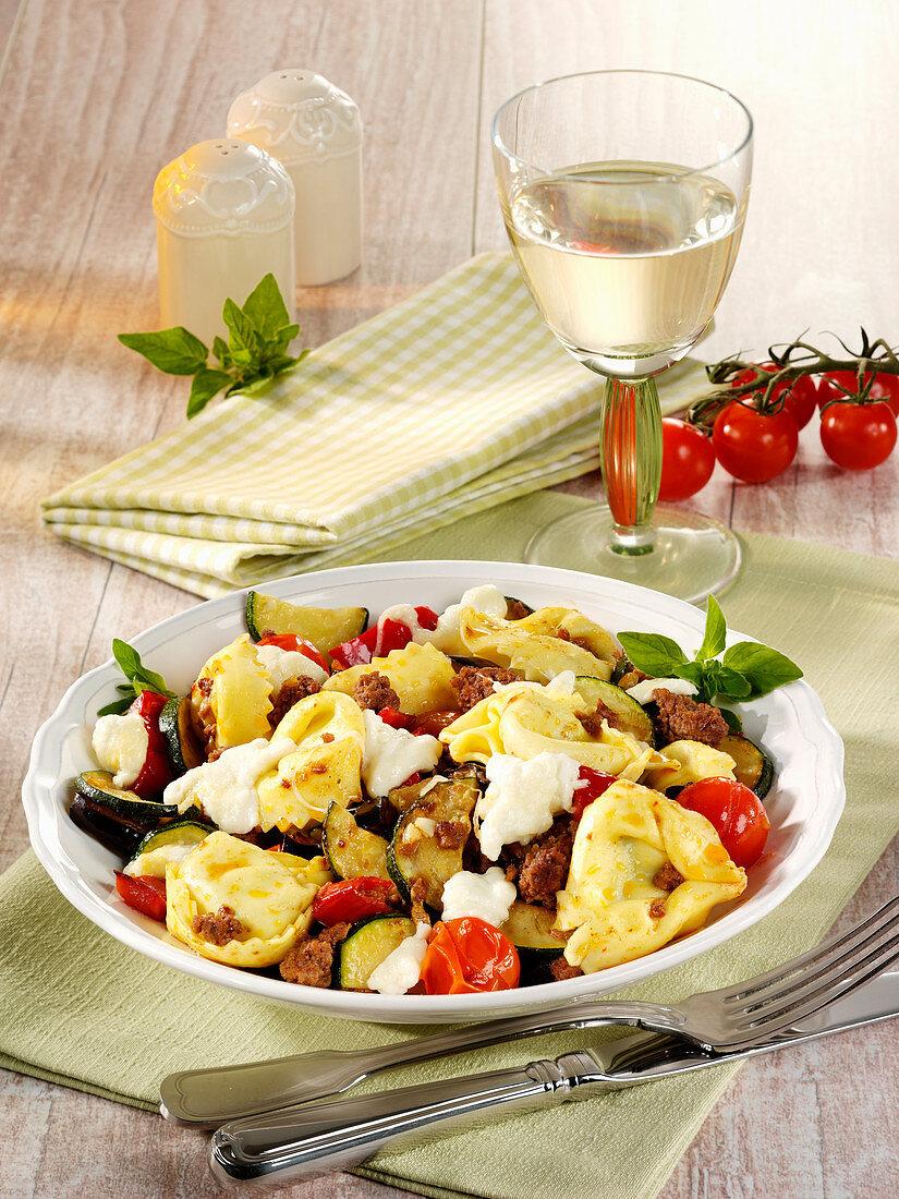 Tortetllini bolognese with vegetables and mozzarella