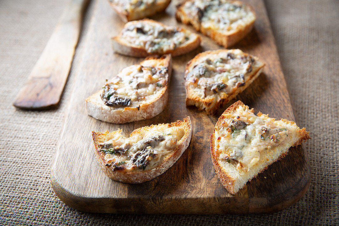 Winter chanterelle mushrooms with cheese, on toast