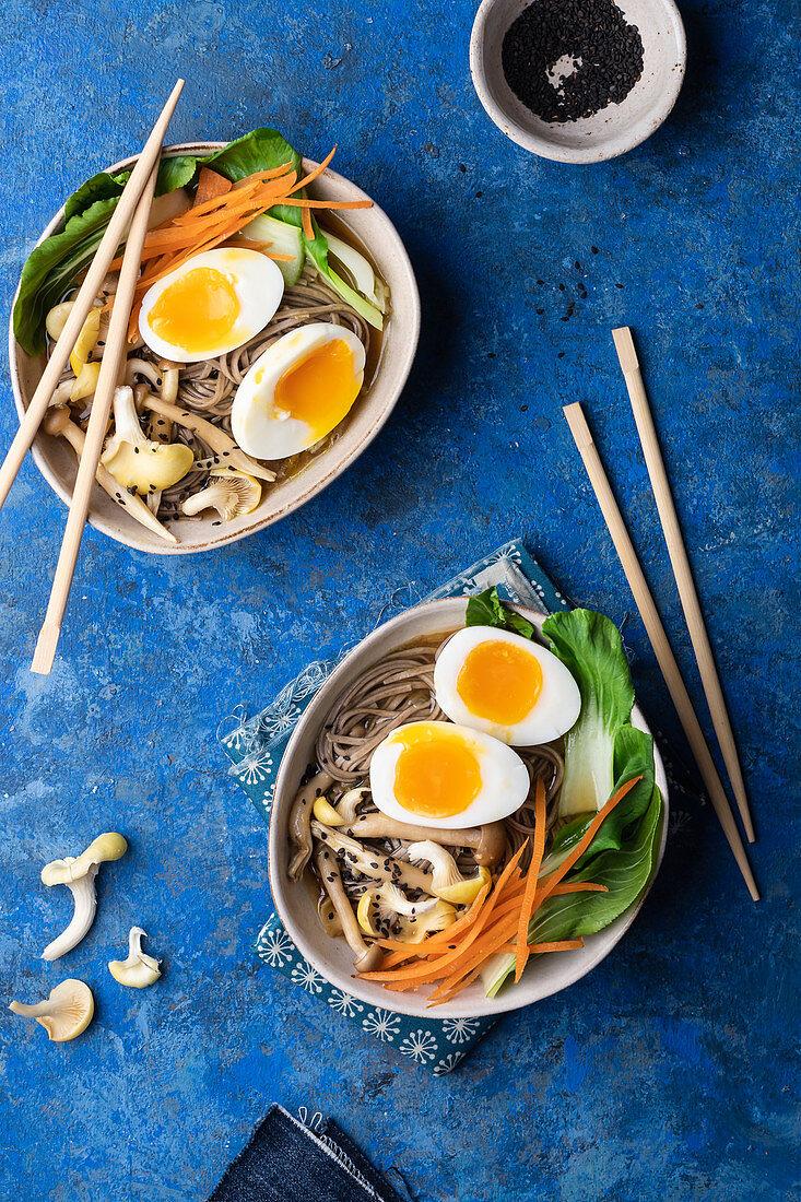 Miso soup with pak choy, carrot, soba pasta, lemon oyster mushrooms, egg and black sesame seeds