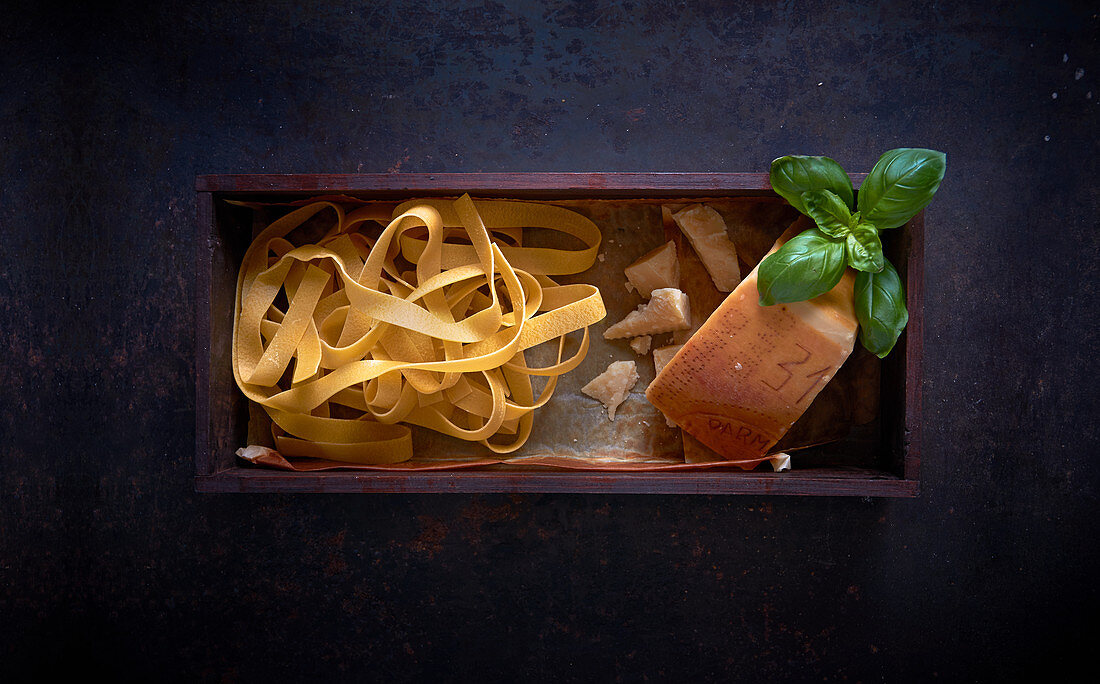 Papardelle with Parmesan cheese and basil in a wooden box