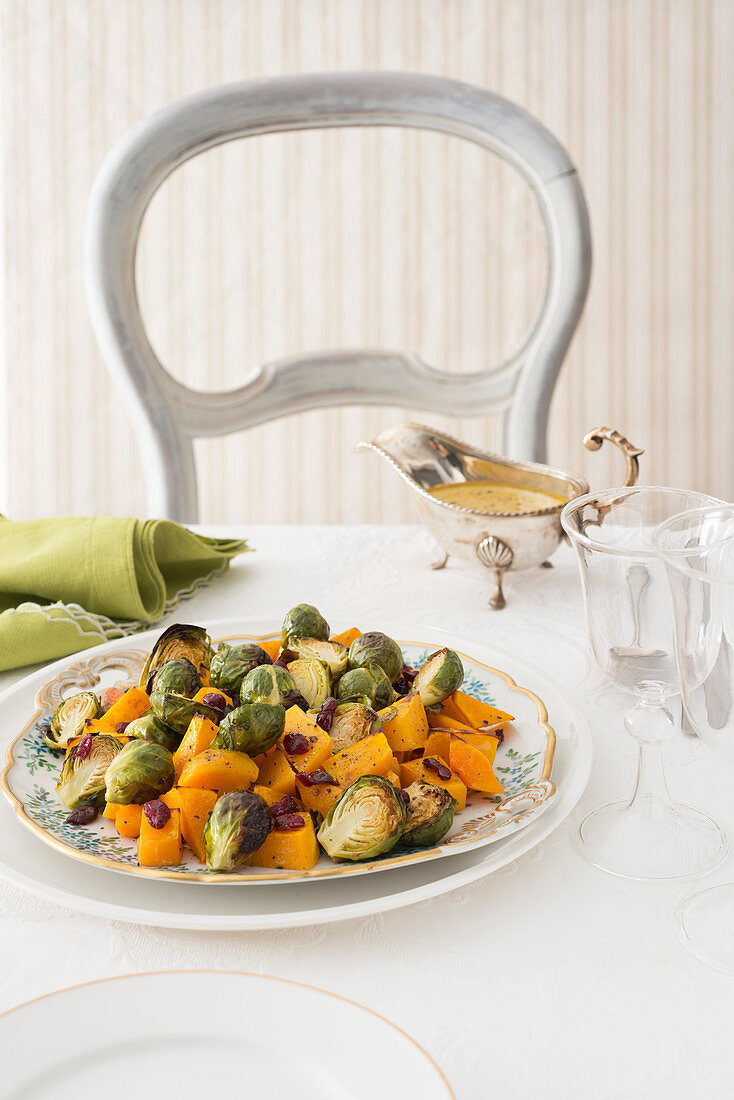 Oven-roasted pumpkin and Brussels sprouts with cranberries and a mustard vinaigrette