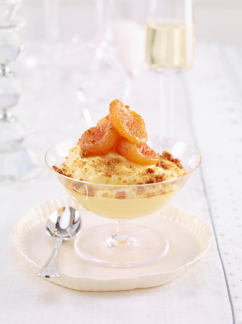 Ginger and cinnamon cream with white wine apricots and gingerbread crumbs