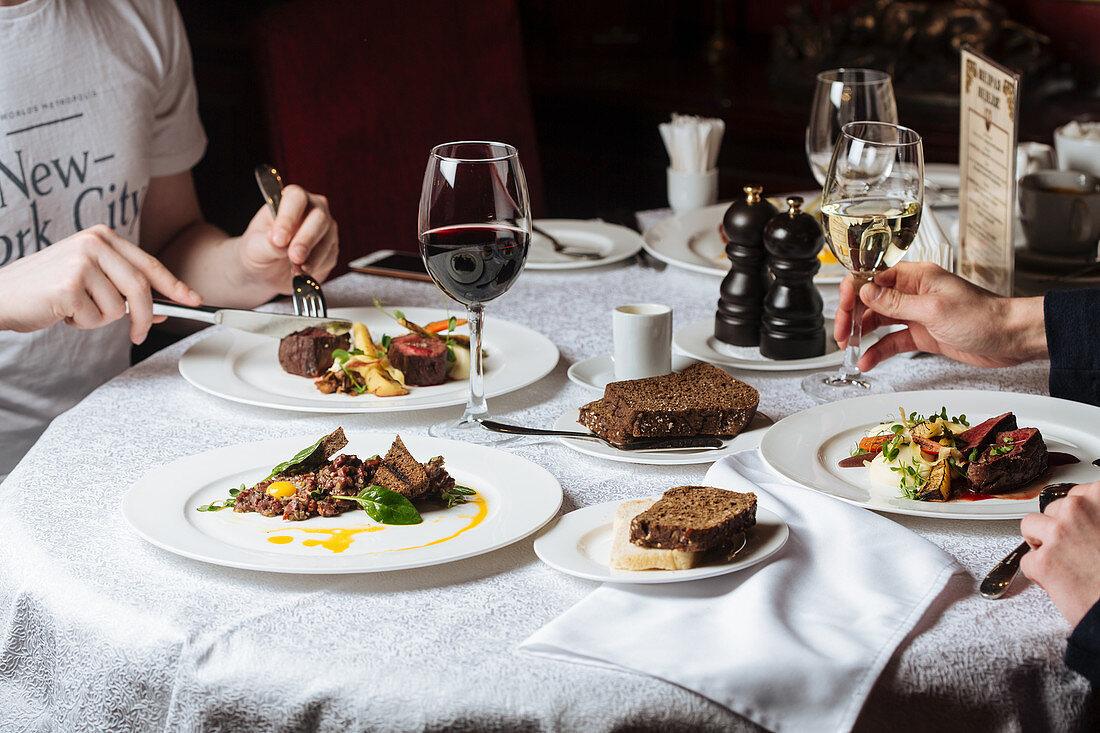 Men having dinner in luxury restaurant