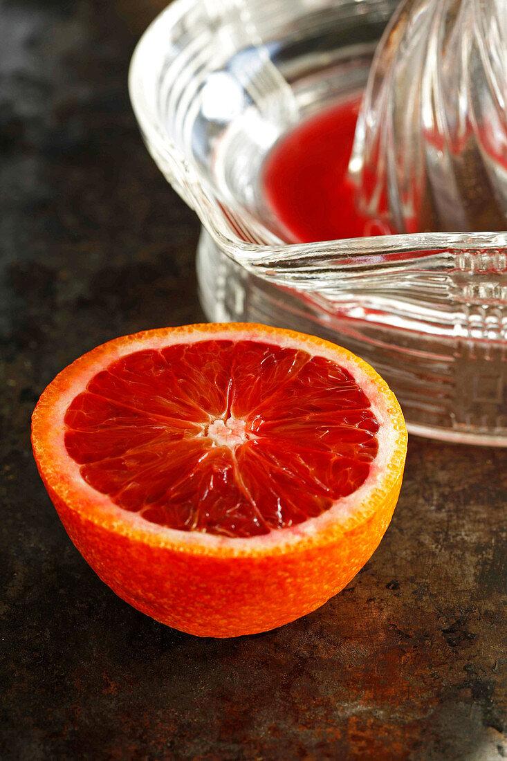 Blood orange and juice on dark background