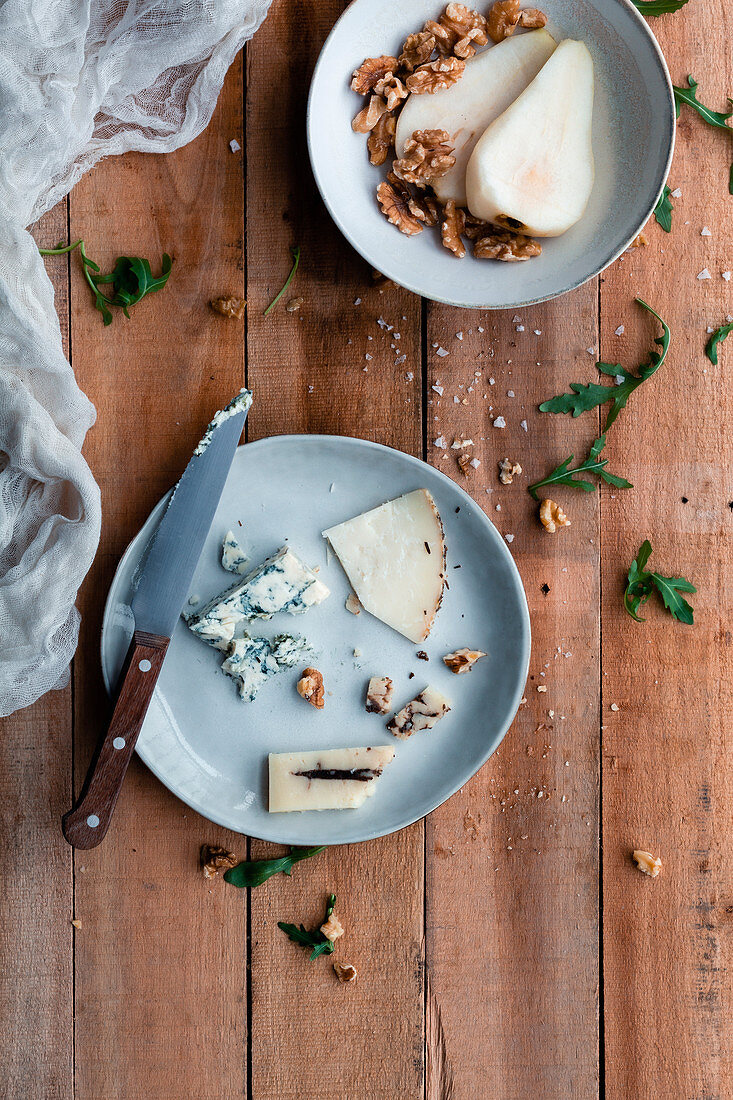 Pear and walnuts salad with cheese and arugula