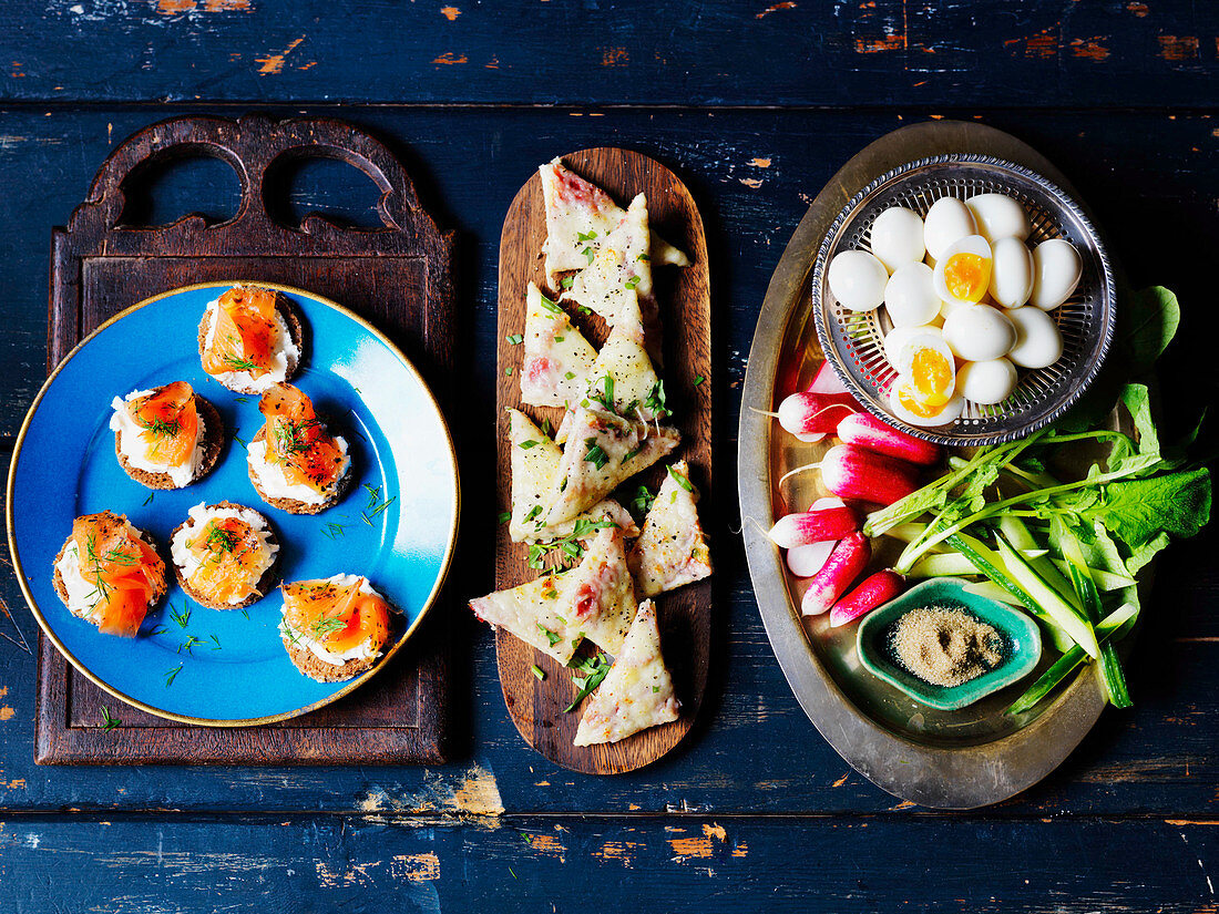 Quail eggs, radish, cucumber, toast with cheese, canape with smoked salmon