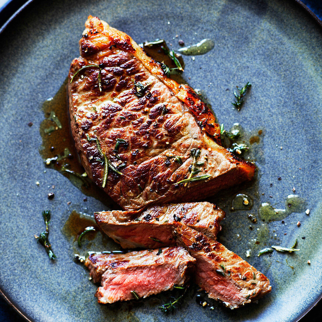 Cut beef steak with herbs