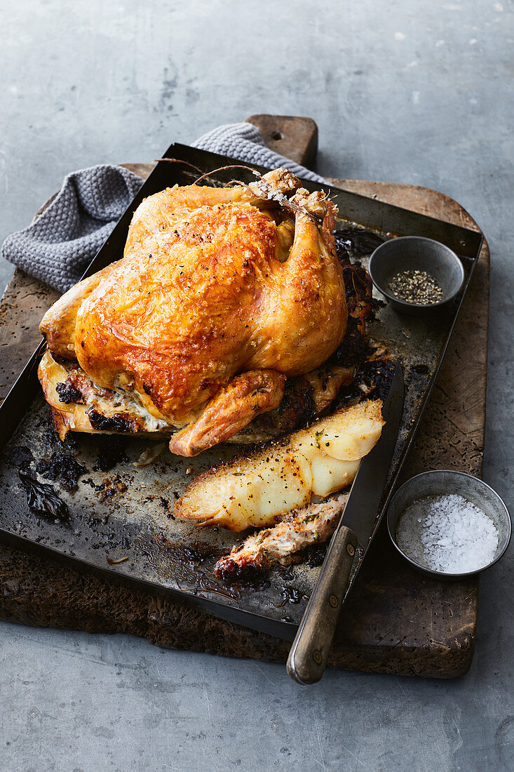 Festive roast chicken with sausage and prune stuffing