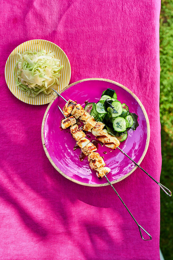 Grilled tofu with soy sauce, cucumber salad and white cabbage
