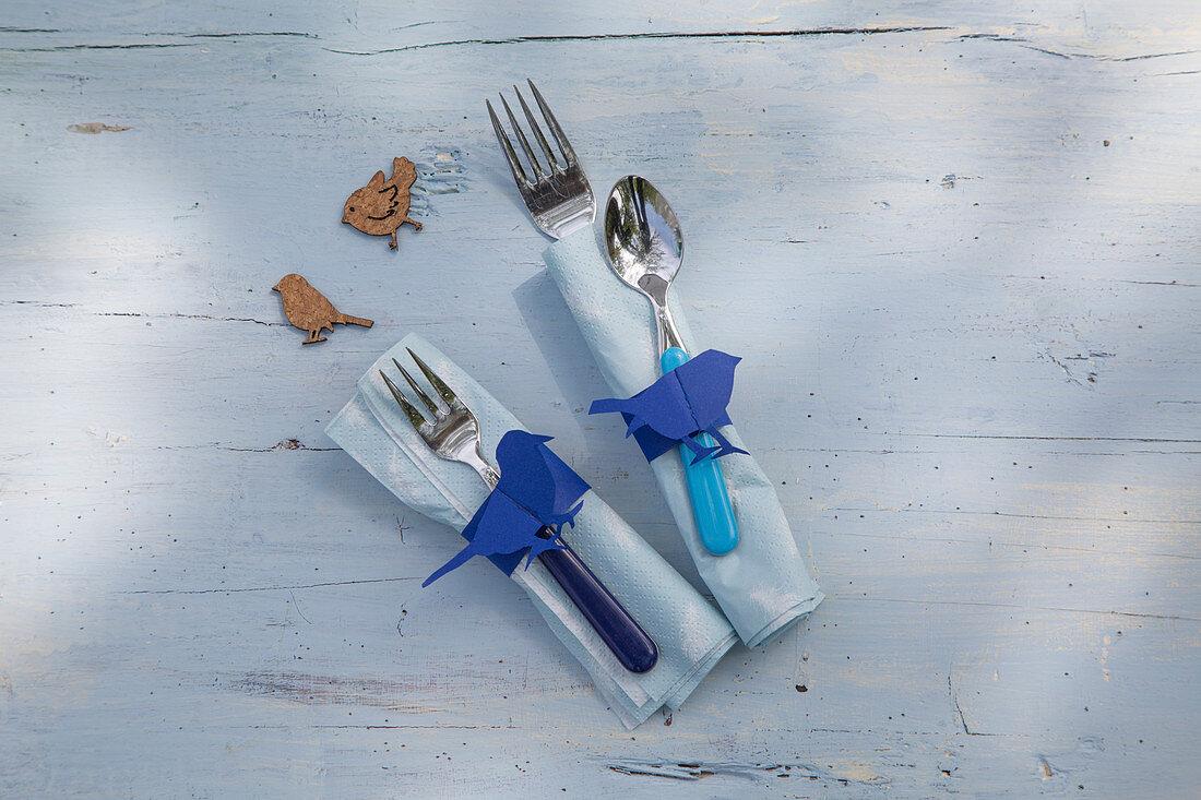 Handmade paper napkin rings with blue bird motifs