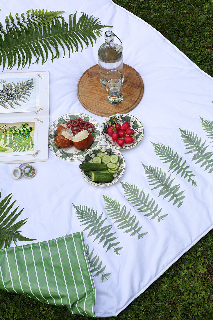 Snacks on handmade picnic blanket with fern motifs