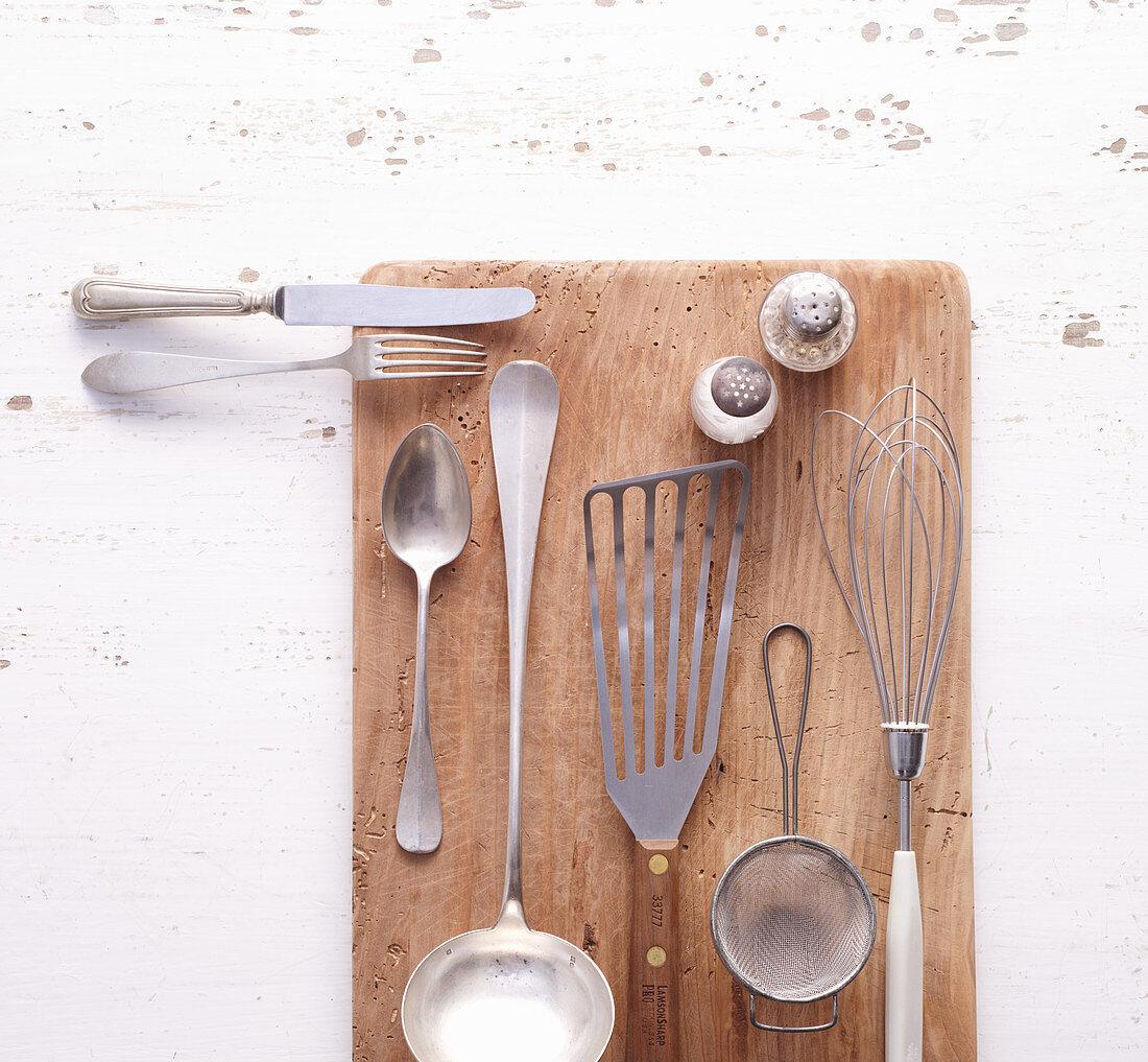 Different kitchen utensils on a cutting board