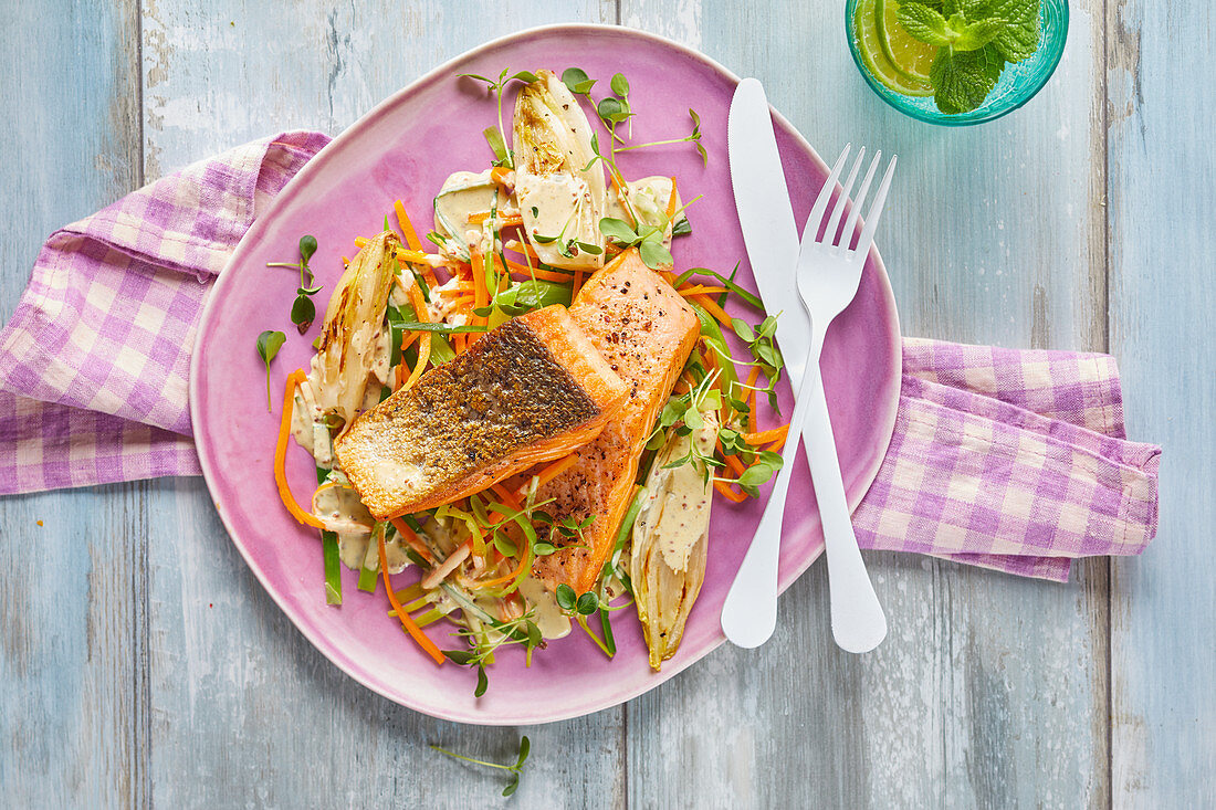 Salmon fillets on vegetables