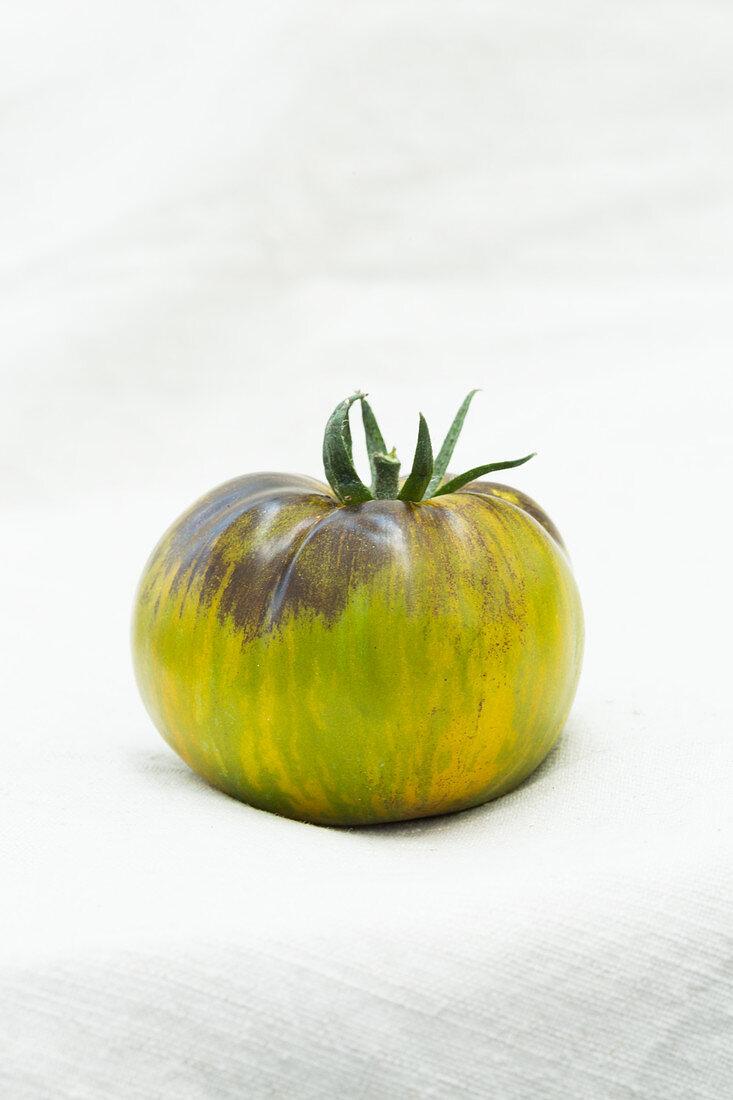 Green tomato on a white background