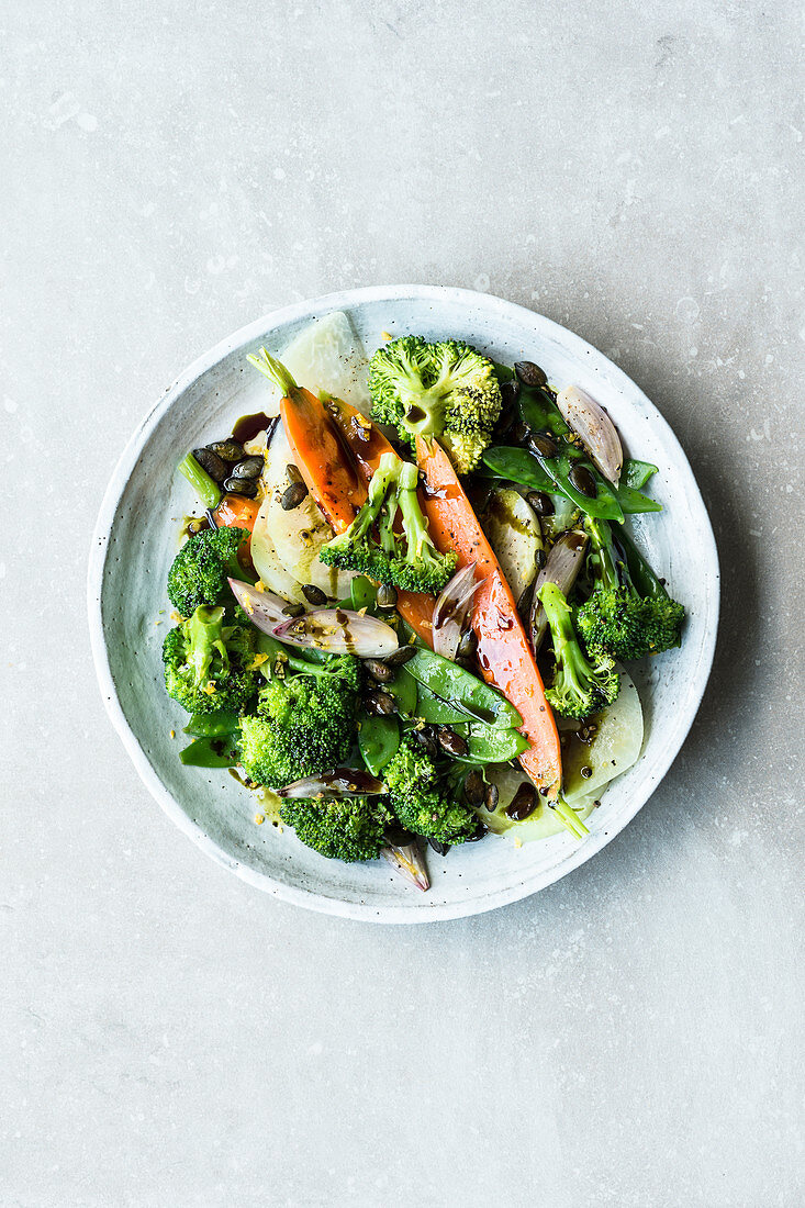 Green spring vegetables with pumpkin seeds