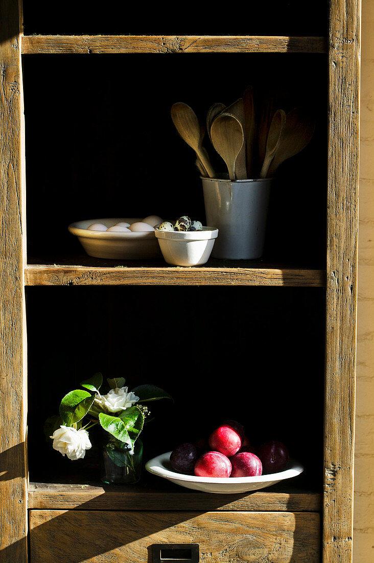 Kitchen storecupboard of fruit and utensils