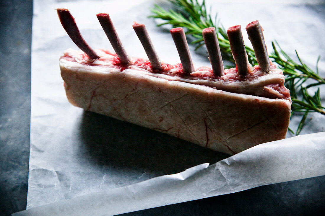 Rack of lamb on greeseproof with rosemary pre cook