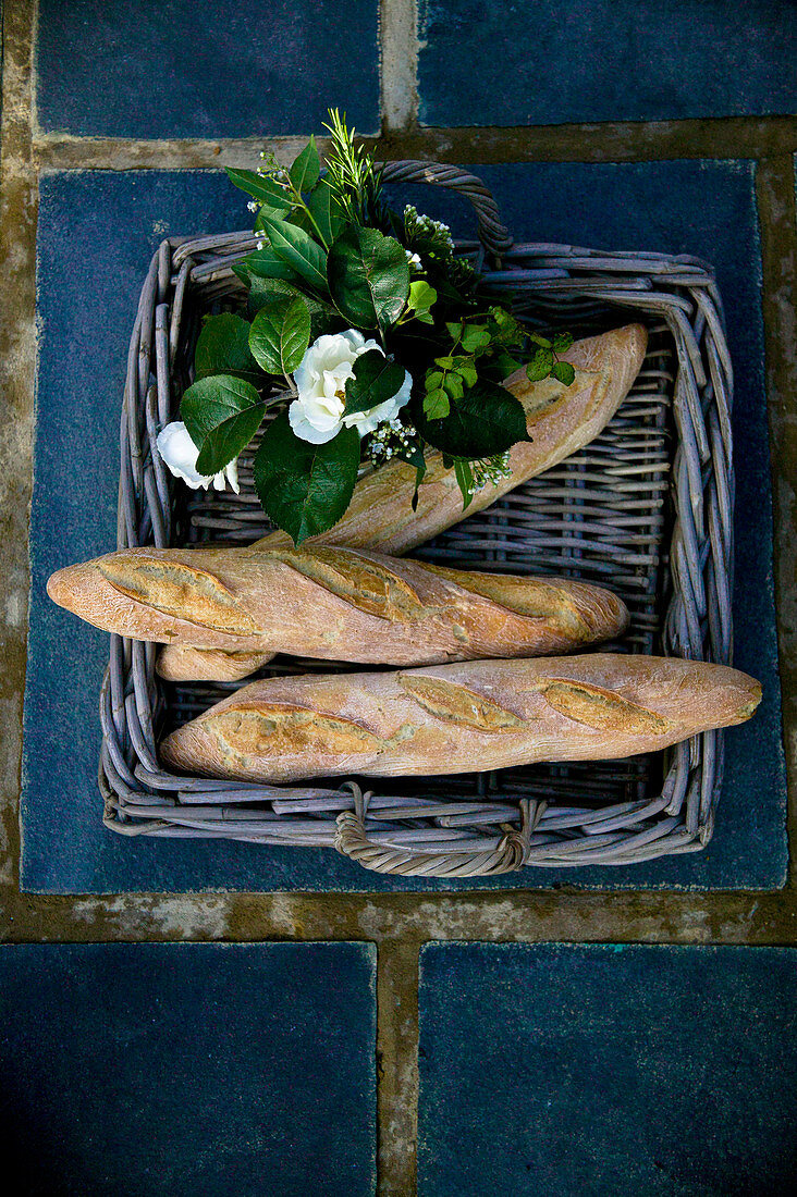 Wicker tray of bread and flowers