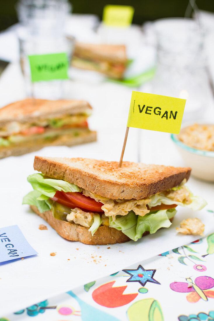 Vegan whole grain sandwich with chickpea spread