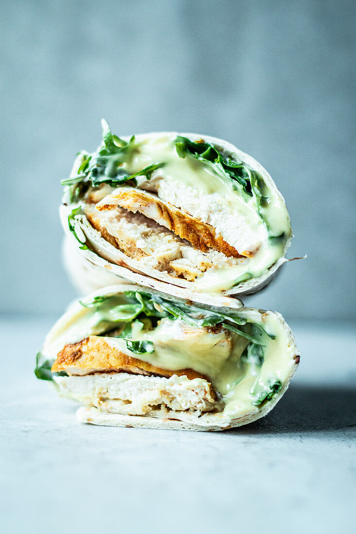 Wraps with chicken breast, arugula and honey mustard sauce