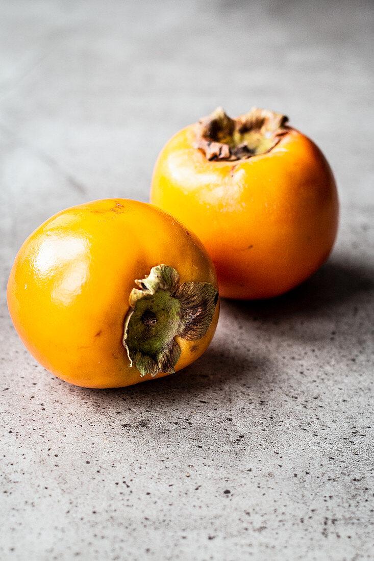 Two fresh sharon fruit
